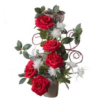 Bouquet of red roses and edelweiss In plastic, with decorative foliage