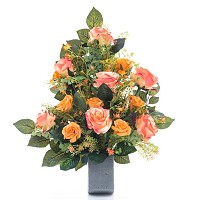 Bouquet of pink and salmon roses In plastic, with decorative foliage