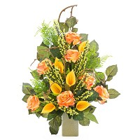 Bouquet of salmon roses and yellow calla In plastic, with decorative foliage