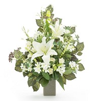Bouquet of lilies In plastic, with decorative foliage