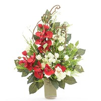 Bouquet of red orchids In plastic, with decorative foliage